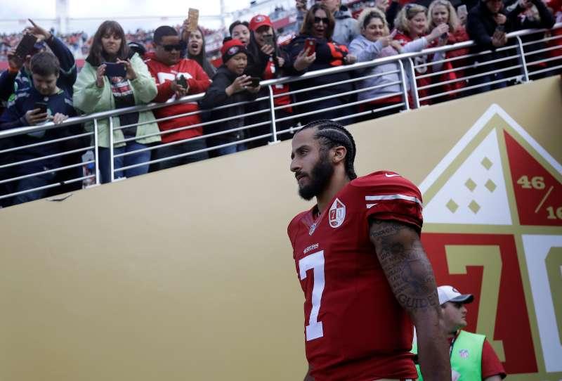 Former San Francisco 49ers quarterback Colin Kaepernick walks onto the field ahead of a January 2017 game.