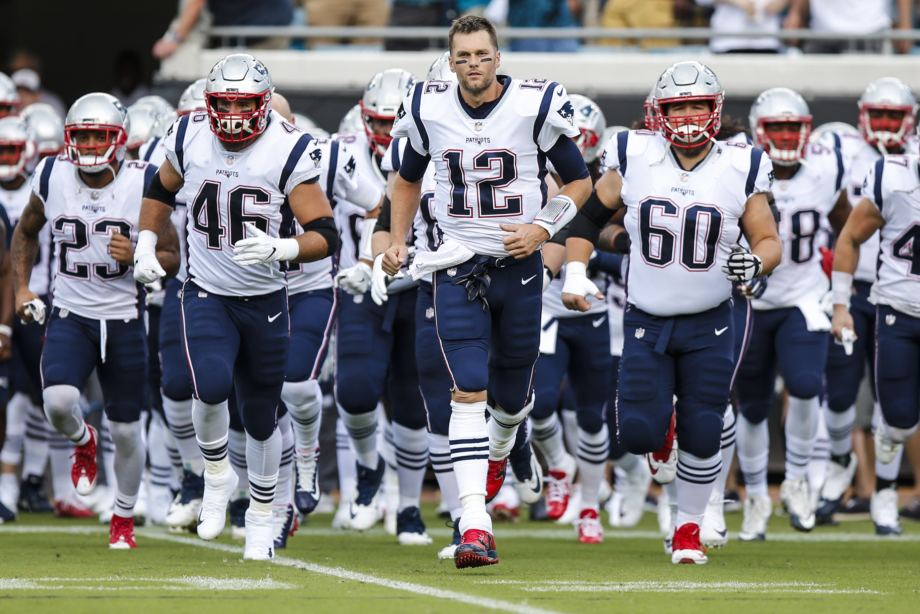 New England Patriots quarterback Tom Brady (12) leads the team out prior to the game between the New England Patriots and the Jacksonville Jaguars on September 16, 2018 at TIAA Bank Field in Jacksonville, Fl.