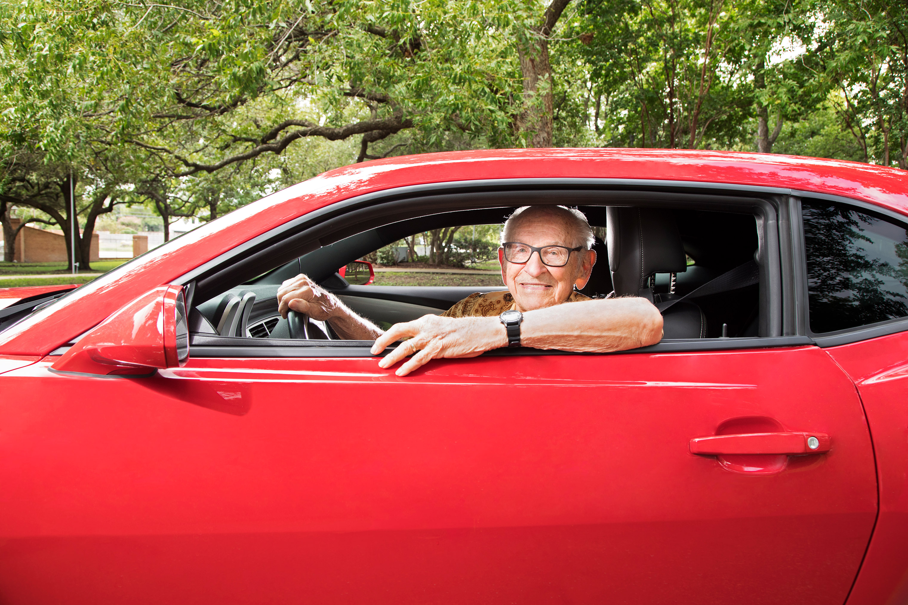 Orville Rogers, age 100, in his cherished 2013 Chevy Camaro, is still cruising after 40 years of retirement.