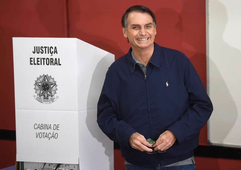 Brazil's right-wing presidential candidate for the Social Liberal Party (PSL) Jair Bolsonaro smiles after casting his vote during general elections, in Rio de Janeiro, Brazil, on October 7, 2018.