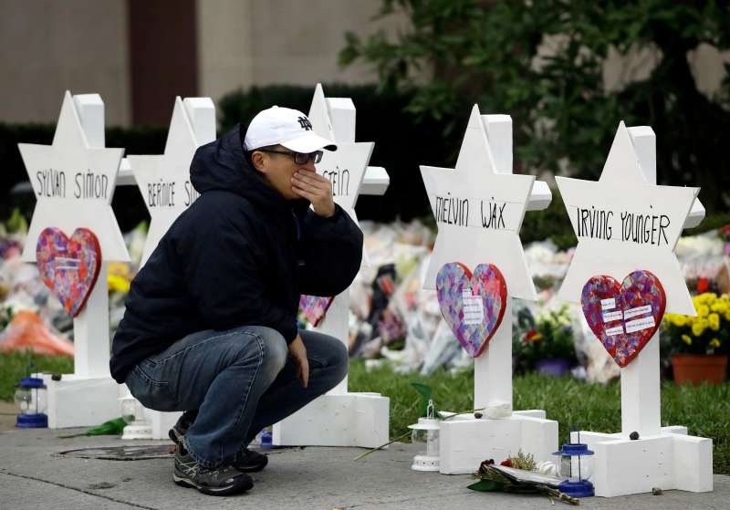 A person pauses in front of Stars of David with the names of those killed in a deadly shooting at the Tree of Life Synagogue, in Pittsburgh, October 29, 2018.
