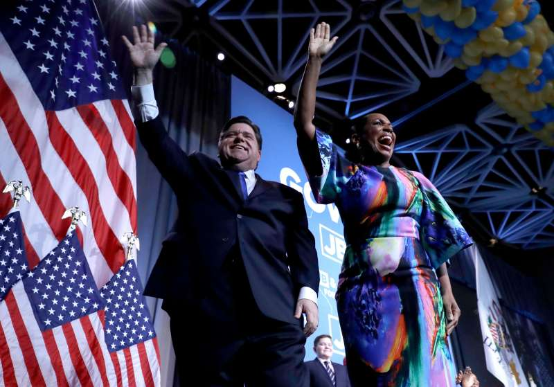 J.B. Pritzker, Juliana Stratton. Democratic gubernatorial candidate J.B. Pritzker, left, and his running mate lt. governor candidate, Juliana Stratton, wave to supporters after Pritzker defeated incumbent Gov. Bruce Rauner in Chicago             Election 2018 Governor Pritzker Illinois, Chicago, November 6, 2018.