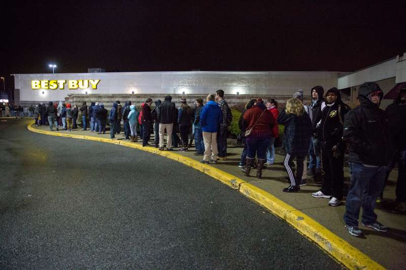 The line outside of Best Buy wraps all the way around the building at the Maine Mall just before midnight on Thanksgiving.