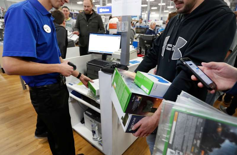 Shopper checks out at a Best Buy store on a previous Black Friday.