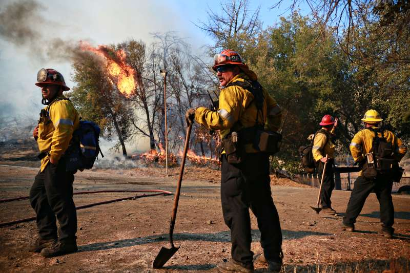Firefighters battle a blaze at the Salvation Army Camp on November 10, 2018 in Malibu, California.