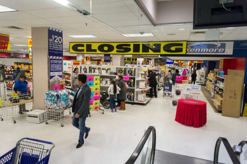 Customers search for bargains at the Sears store closing in the New York borough of the Bronx.