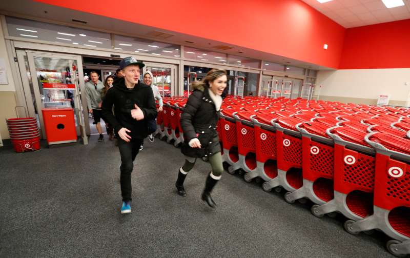 Shoppers run into Target as it opens for  Black Friday  deals on Thanksgiving Day.
