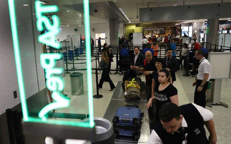 MIAMI, FL - JUNE 02:  Travelers go through the TSA Pre-check line at Miami International Airport on June 2, 2016 in Miami, Florida. As the busy summer travel season heats up the Transportation Security Administration is encouraging people to sign up for the TSA Pre-check program to save time going through the airports security lines. Those enrolled in the program can leave their shoes, light outerwear and belt on during the terminal screening process as well as keeping their laptop in the carry-on suitcase without having to remove them at the checkpoint. (Photo by Joe Raedle/Getty Images)