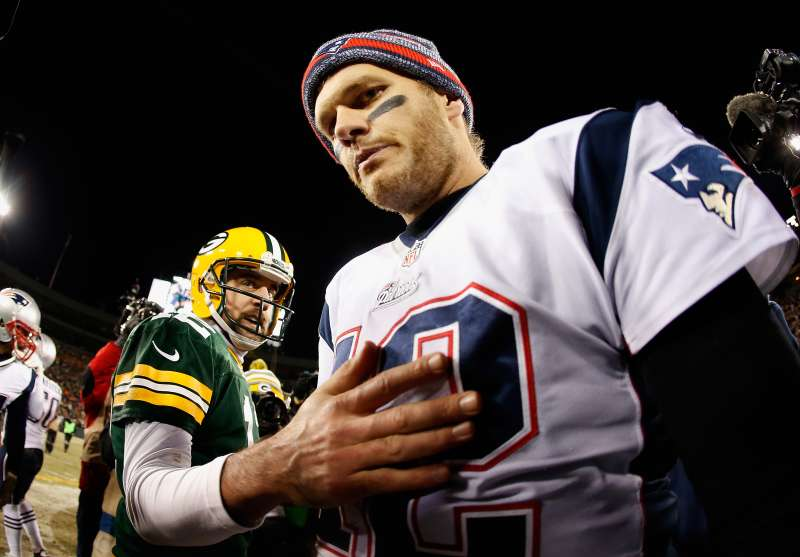 Quarterback Tom Brady of the New England Patriots walks away from Aaron Rodgers of the Green Bay Packers after shaking hands following the Packers 26-21 win at Lambeau Field on November 30, 2014.
