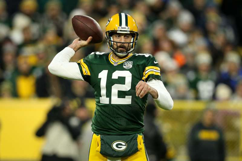 Aaron Rodgers #12 of the Green Bay Packers throws a pass against the Miami Dolphins at Lambeau Field on November 11, 2018 in Green Bay, Wisconsin.