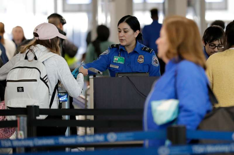 A TSA worker works at O'Hare International Airport in Chicago, December 25, 2018.