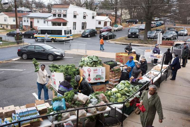 Volunteers and church members of First Baptist Church of Capital Heights help organize hand out food to people, Maryland  on December, 27, 2016. This church is a drop off location for  The Capital Area Food Bank.
