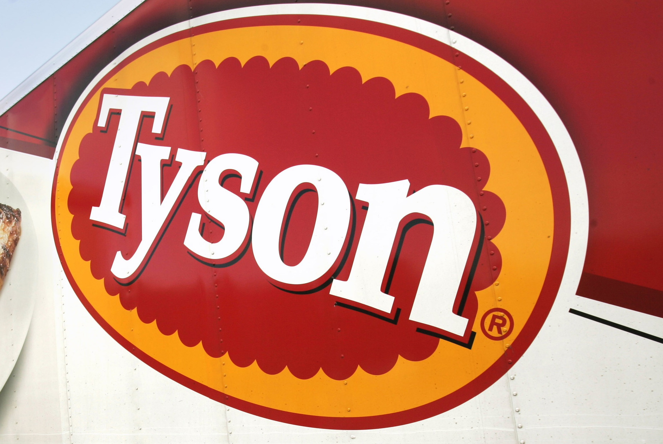 FILE - In this Oct. 28, 2009, file photo, a Tyson Foods, Inc., truck is parked at a food warehouse in Little Rock, Ark.  Tyson Foods is recalling more than 36,000 pounds (16,329 kilograms) of chicken nuggets because they may be contaminated with rubber.  The U.S. Agriculture Department says there were consumer complaints about extraneous material in 5-pound (2 kilogram) packages of Tyson White Meat Panko Chicken Nuggets. There are no confirmed reports of adverse reactions.  (AP Photo/Danny Johnston, File)