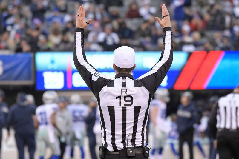 A referee gestures during the second half of an NFL football game between the New York Giants and the Dallas Cowboys, in East Rutherford, N.J             Cowboys Giants Football, East Rutherford, December 30, 2018.