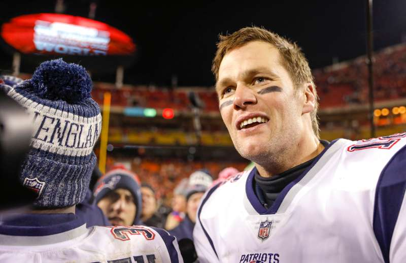 Quarterback Tom Brady #12 of the New England Patriots smiles following the Patriots' 37-31 overtime win in the AFC Championship Game against the Kansas City Chiefs at Arrowhead Stadium on January 20, 2019 in Kansas City, Missouri.