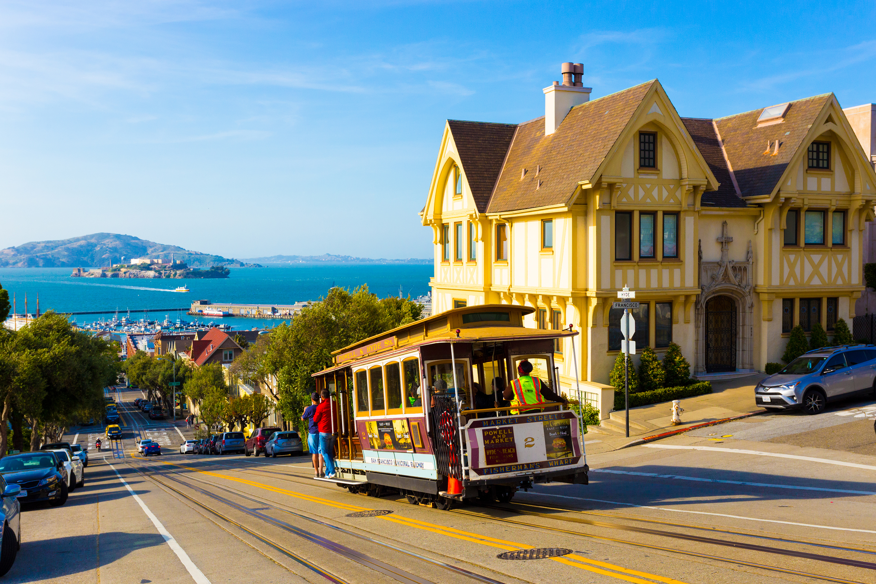 Combined scenic view of San Francisco Bay with Alcatraz, cable car, Victorian houses, typical iconic siteseeing landmarks and tourist attractions of the city