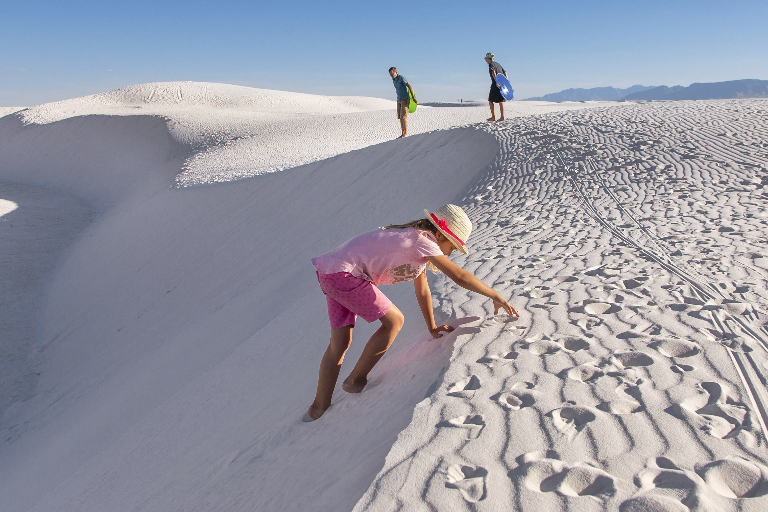 Visitors flock to the dramatic White Sands National Monument near Las Cruces.