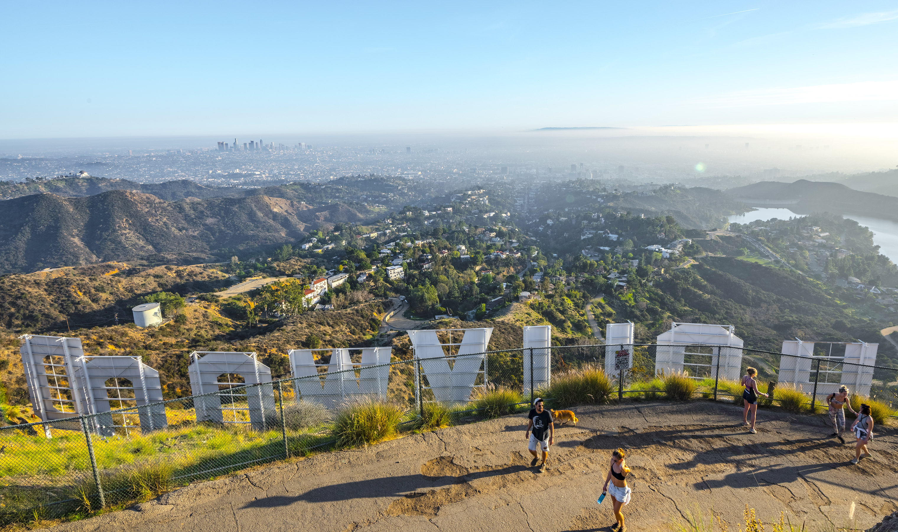 Hikers take in the view from the iconic Hollywood sign in the Hollywood Hills.