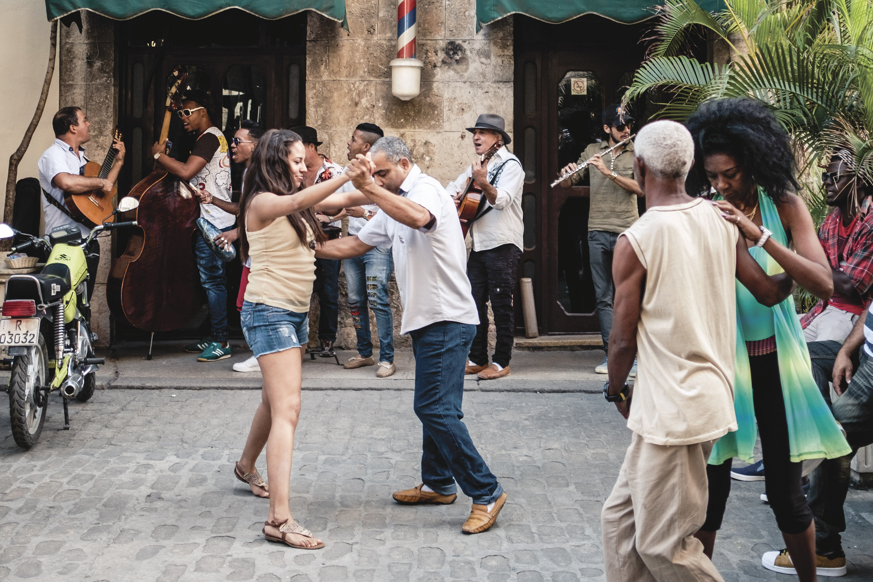 People dance in the streets of Old Havana.