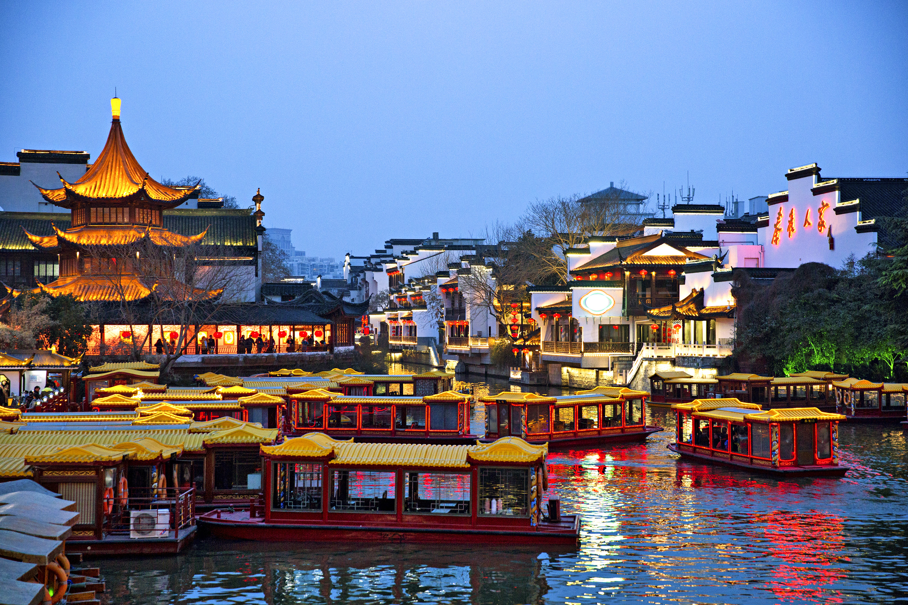 Ships sail the Qinhuai River in Nanjing.
