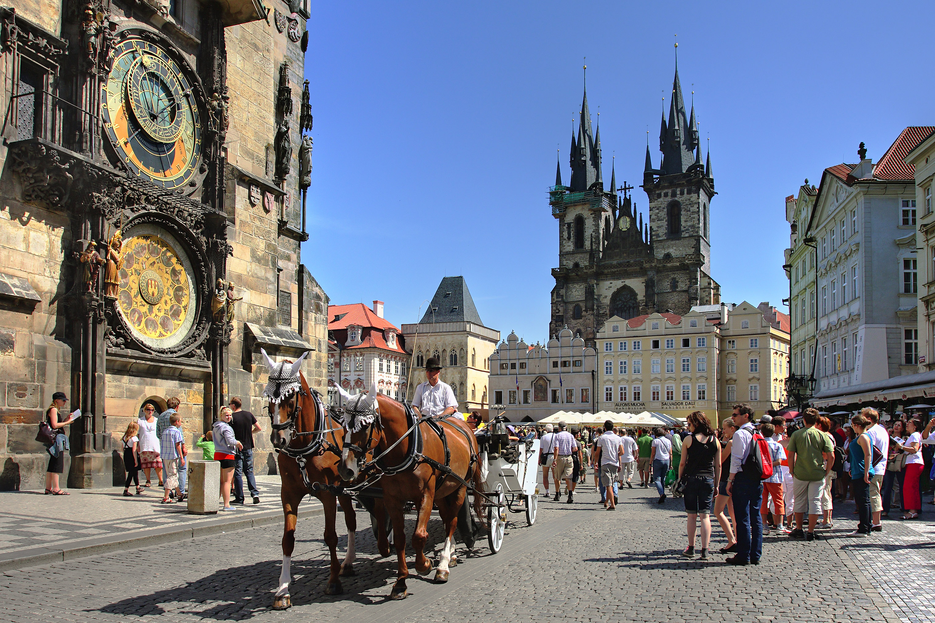 A carriage passes by the historic Old Town Square in Prague.