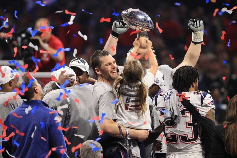 ATLANTA, GA - FEBRUARY 03: Tom Brady #12 of the New England Patriots celebrates with daughter Vivian who raises the Vince Lombardi Trophy after Super Bowl LIII at Mercedes-Benz Stadium on February 3, 2019 in Atlanta, Georgia. The New England Patriots defeat the Los Angeles Rams 13-3.  (Photo by Mike Ehrmann/Getty Images)