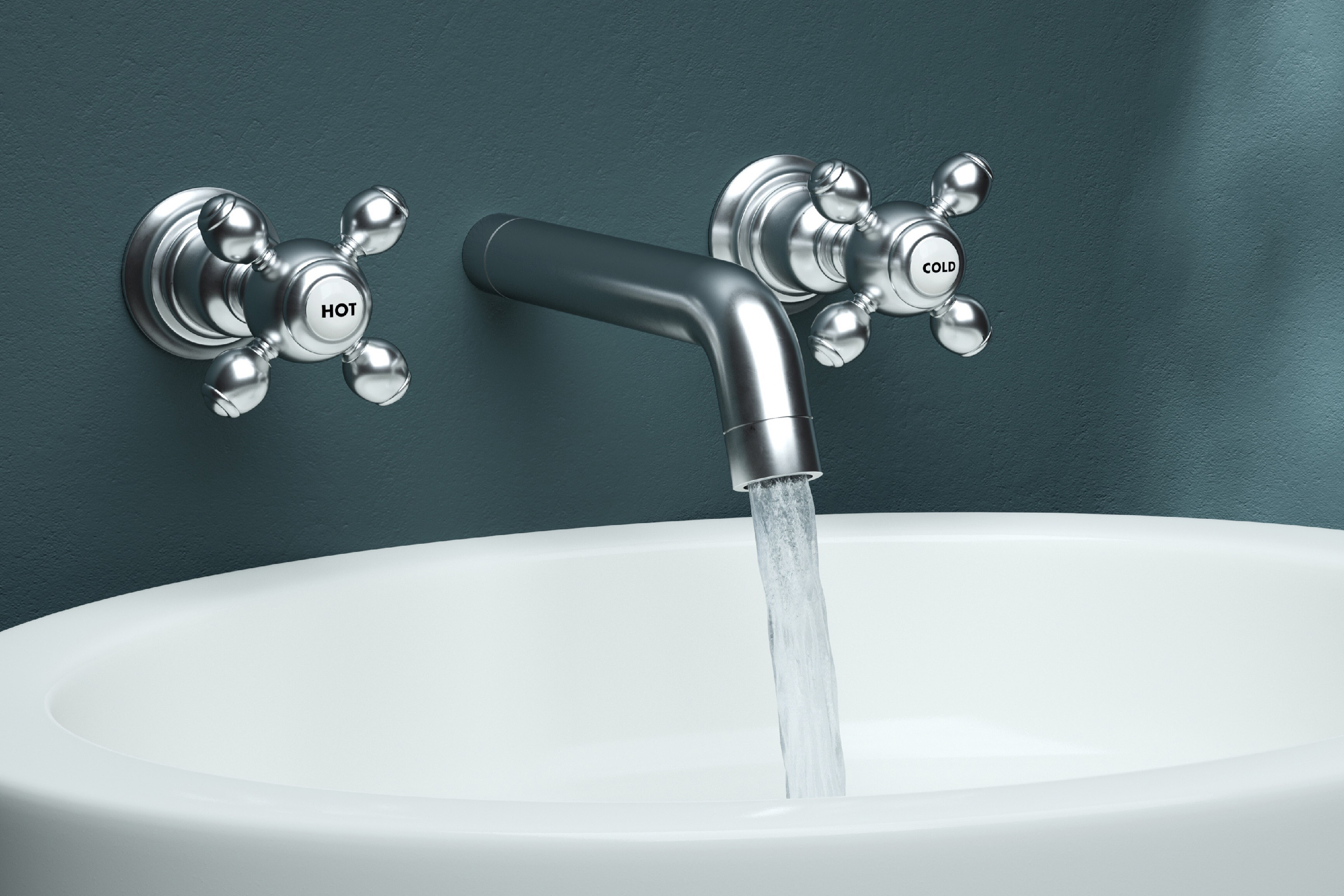 Close-Up Of Water Dripping From Faucet In Sink