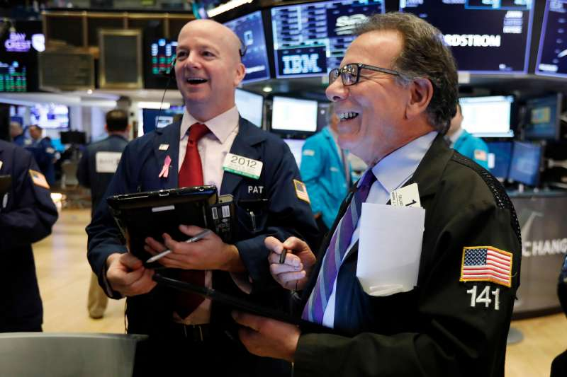 Traders Patrick Casey, left, and Sal Suarino work on the floor of the New York Stock Exchange, . Stocks are opening higher on Wall Street after Chinese and U.S. officials agreed to continue trade talks in Washington next week             Financial Markets Wall Street, New York, February 14, 2019.