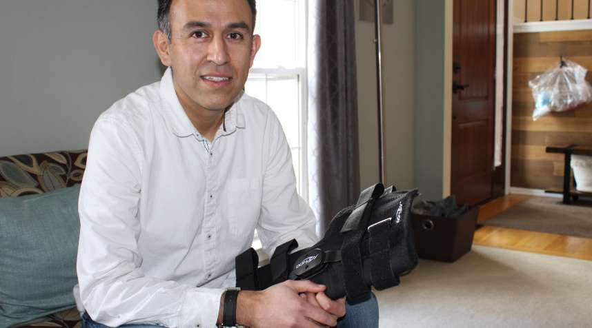 After a sports injury, Esteban Serrano owed $829.41 for a knee brace purchased with insurance through his doctor's office. He says he found the same kind of braces selling for less than $250 online. (Paula Andalo/Kaiser Health News)