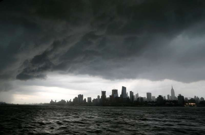 Storm clouds pass over midtown Manhattan and the Empire State Building in New York City