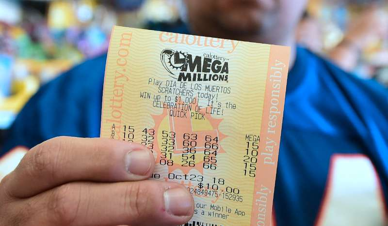 A man shows his lottery tickets on October 23, 2018 ahead of the drawing for the $1.5 billion Mega Millions jackpot.
