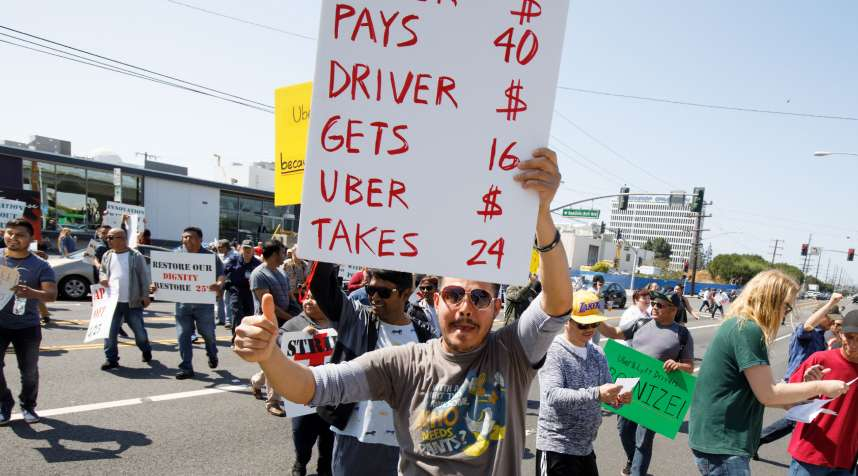 Rideshare drivers from the Los Angeles area protest during a one-day strike outside the Uber Greenlight offices in Redondo Beach, Calif.