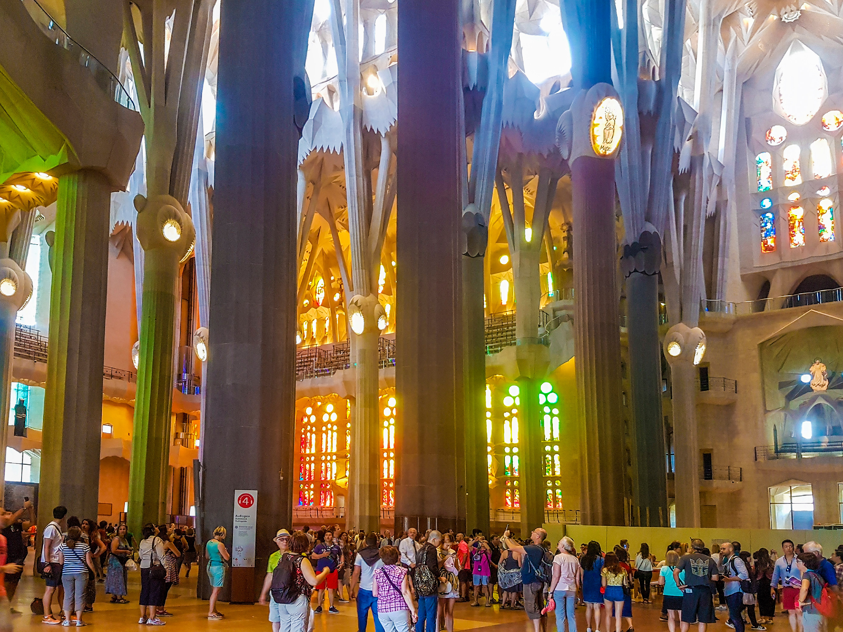 Tourists inside the Sagrada Familia Cathedral, designed by Antoni Gaudi, UNESCO World heritage site, Barcelona, Spain