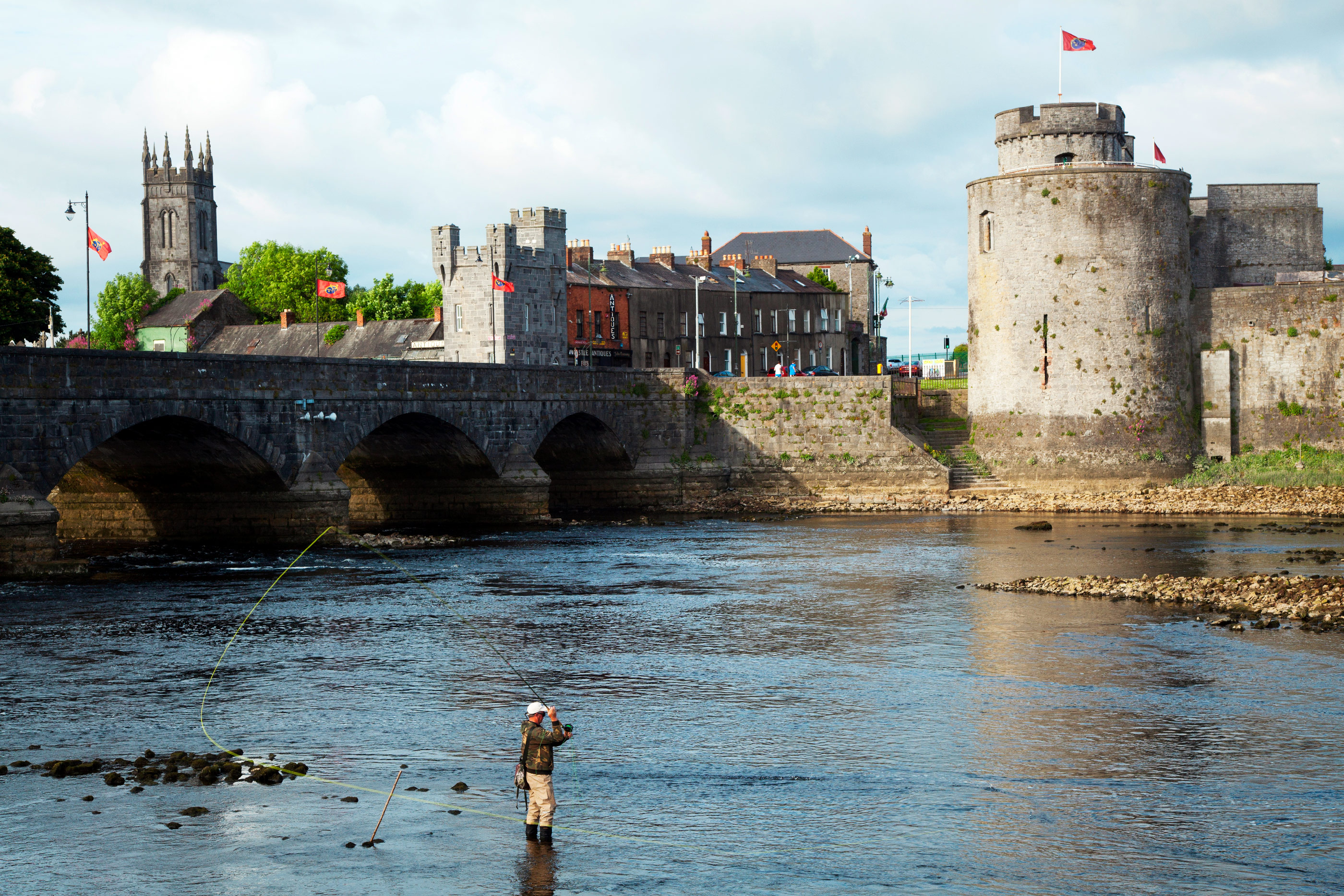 Shannon River with Thomond Bridge and King Johns Castle, Limerick, Ireland