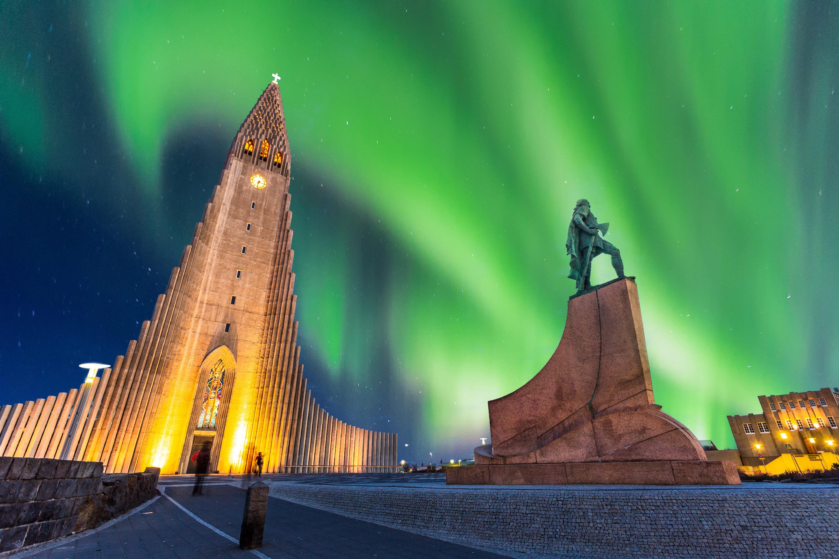 Aurora borealis above Hallgrimskirkja Church in central of Reykjavik city in Iceland