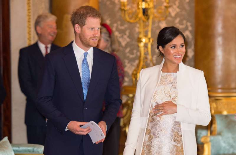 Meghan, Duchess of Sussex, and Prince Harry, Duke of Sussex, attend a reception to mark the 50th anniversary of the investiture of the Prince of Wales at Buckingham Palace on March 5, 2019 in London, England.
