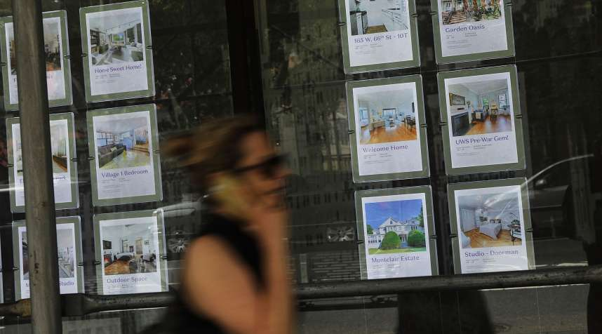Luxury apartments are advertised in a realtor's window on the West Side of Manhattan on July 24, 2018 in New York City.