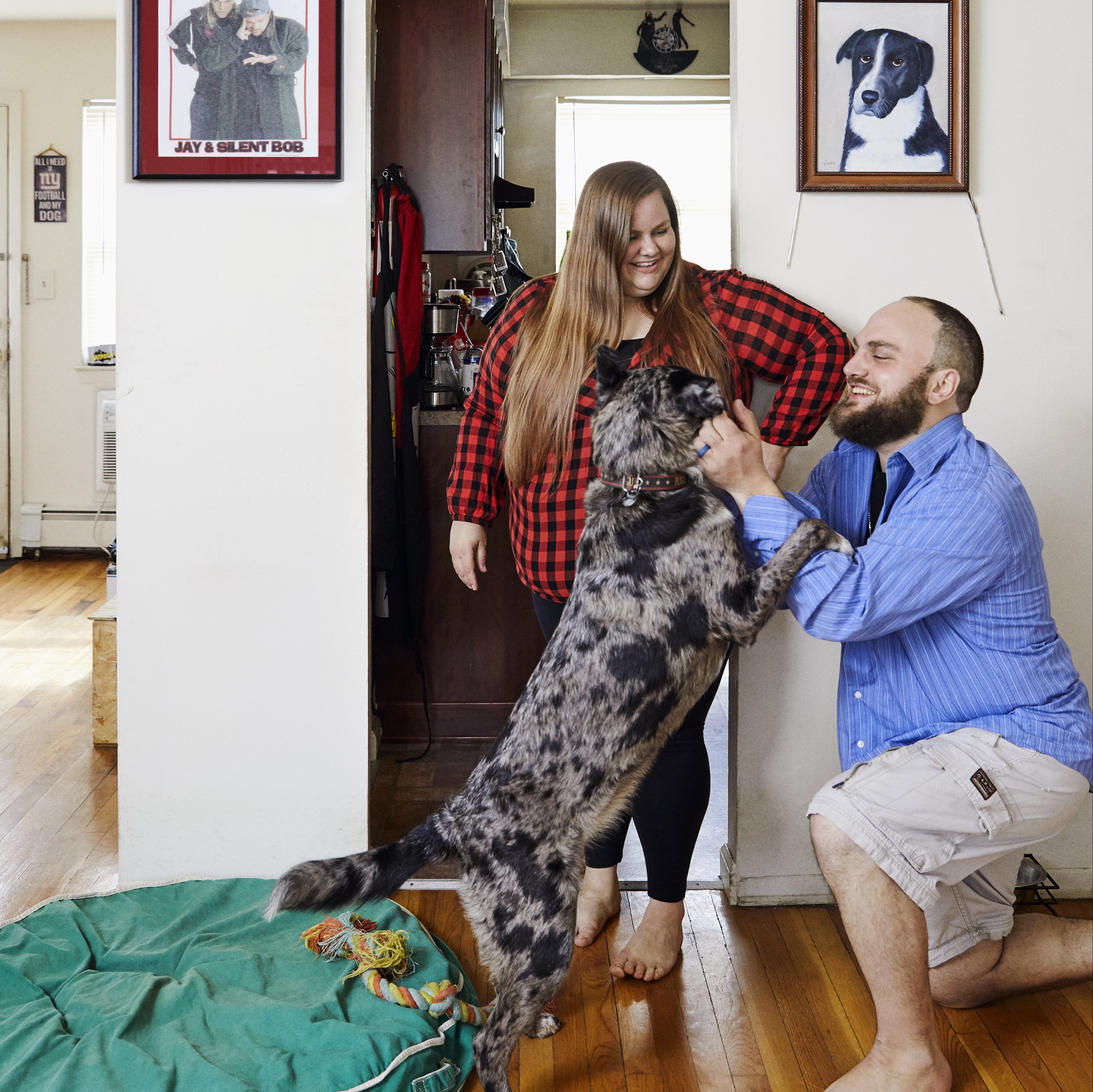 KC and Ryan in their house with their dog