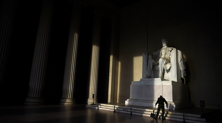 A cleaner sweeps the floor in front of the Lincoln Memorial in Washington, D.C., U.S. April 30, 2019.