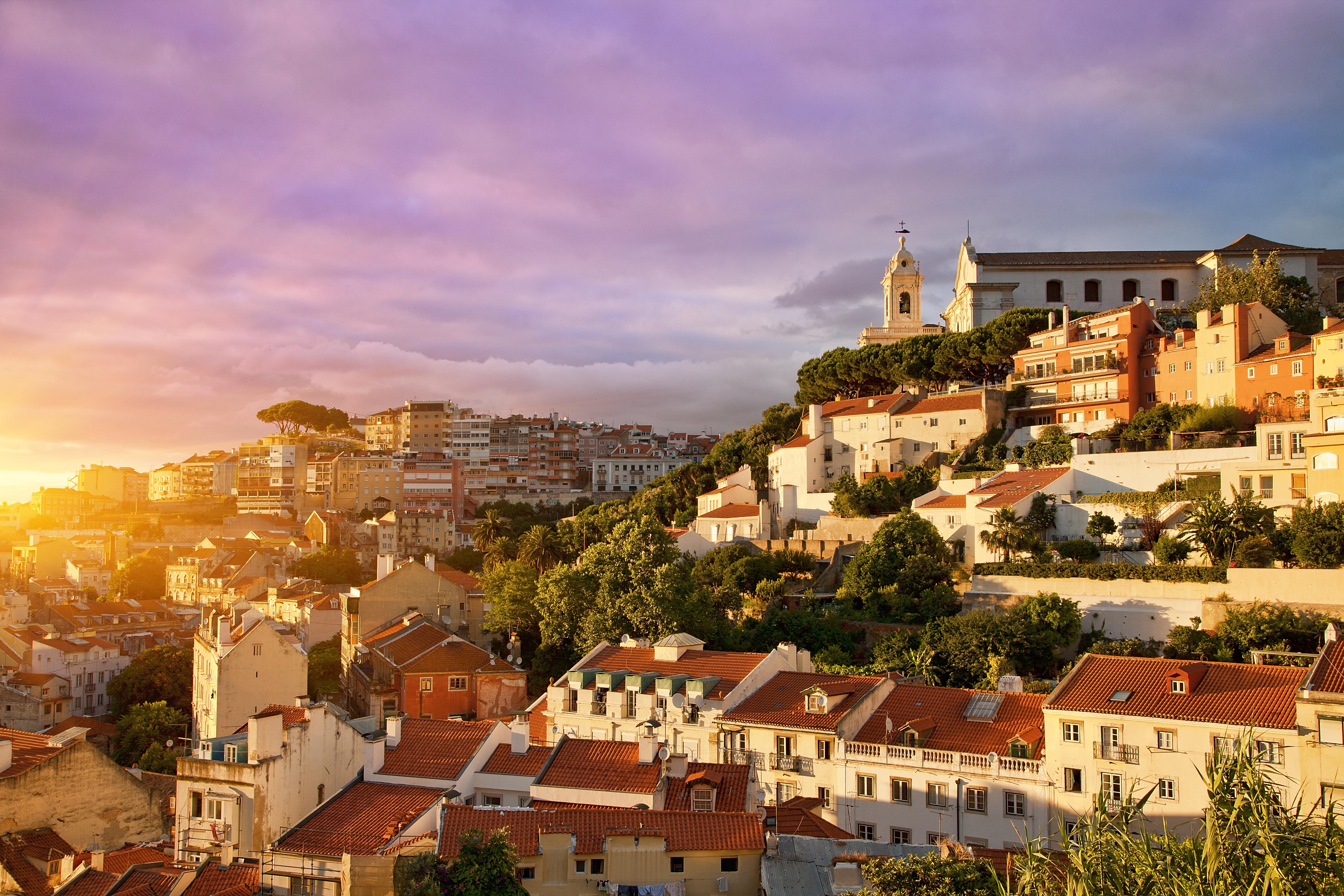 Portugal, Lisbon, Old Town, church and Miradouro de Graca at Sunset