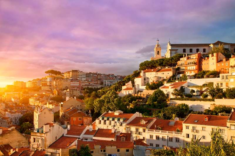 Portugal, Lisbon, Old Town, church and Miradouro de Graca at Sunset