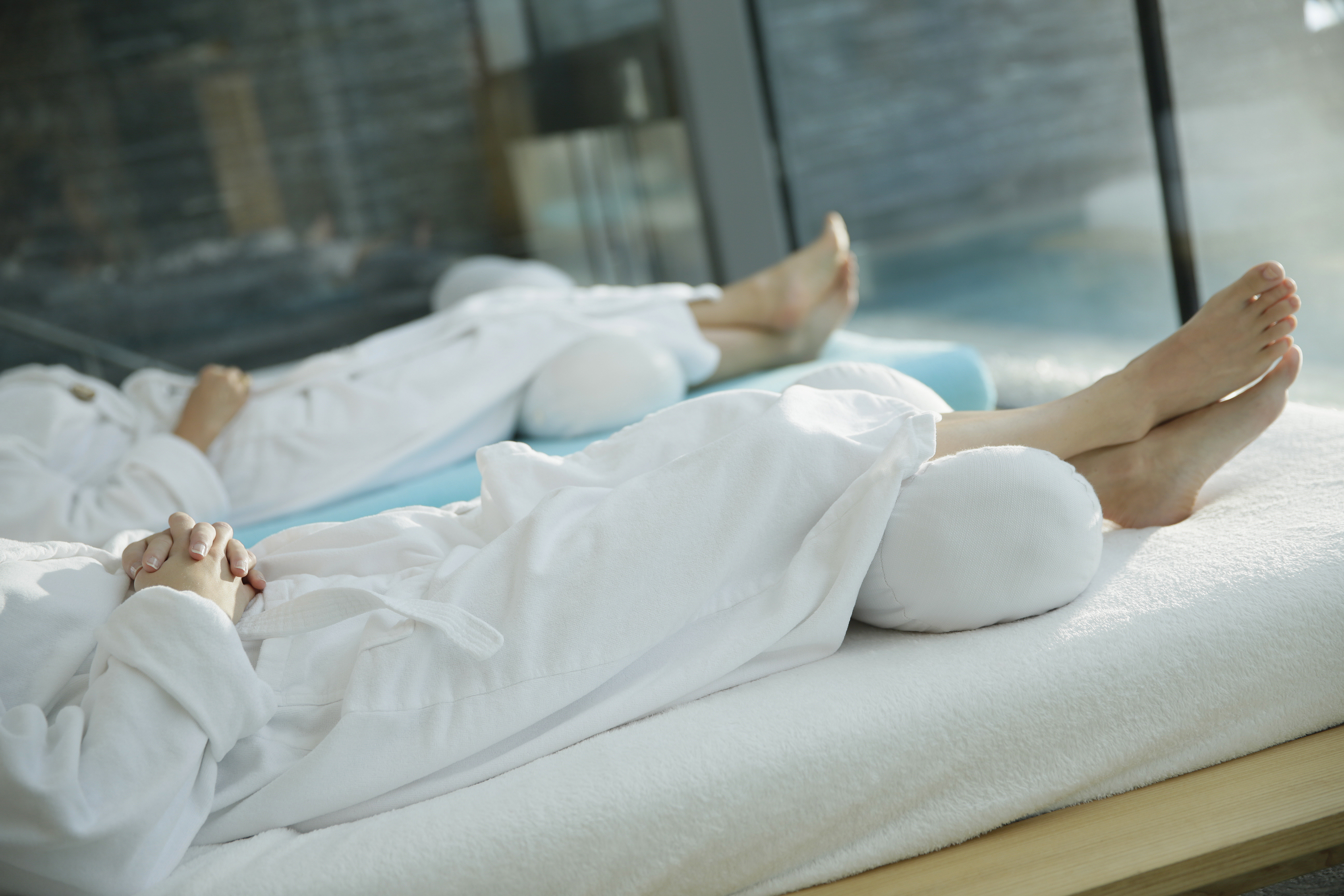 Hotel guests lying on loungers in relaxation room of a hotel, Tannheim, Tannheim valley, Tyrol, Austria
