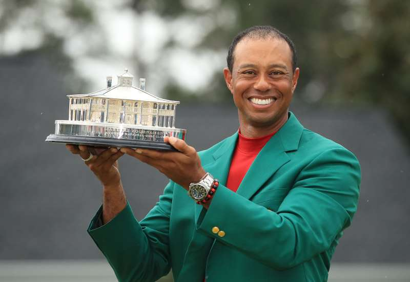Tiger Woods celebrates with the Masters Trophy during the Green Jacket Ceremony after winning the Masters at Augusta National Golf Club on April 14, 2019.