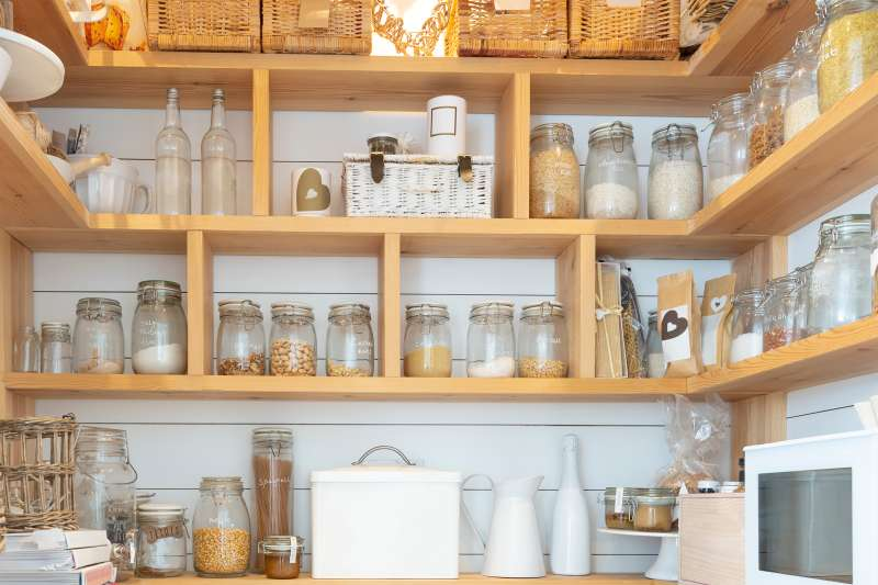 Woven baskets and food jars in pantry