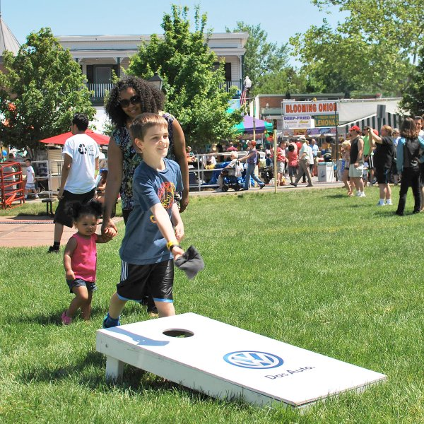 child playing cornhole in Dranesville, Virginia