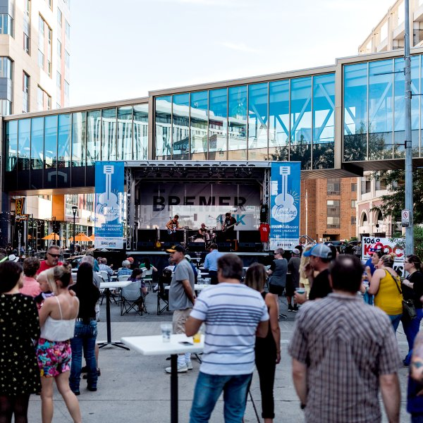 People attending an outdoor concert in downtown Rochester, Minnesota
