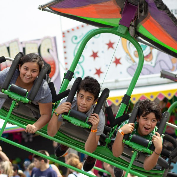 Children on a fair ride in Shawnee, Kansas
