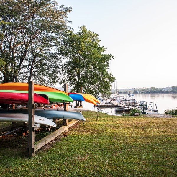 Kayaks stored by a lake in Eagle Creek, Indianapolis, Indiana