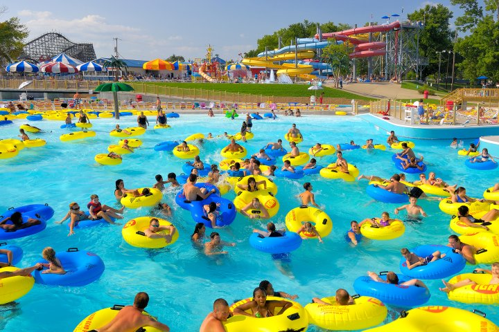 Many people in a lazy river on blue and yellow inner tubes in Bowling Green, Kentucky