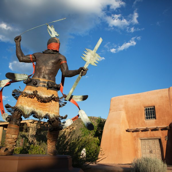 Pueblo style home and sculpture in Santa Fe, New Mexico